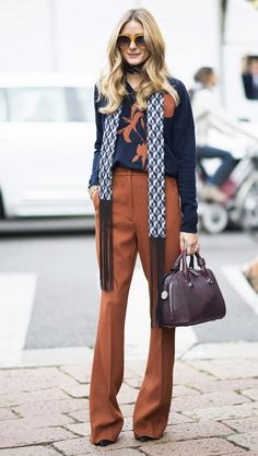 On Olivia Palermo:Max & Co scarf, sweater, and trousers.