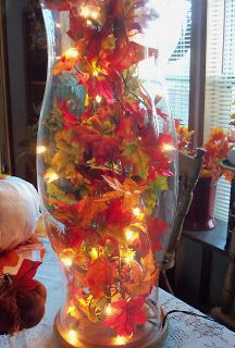 Fall Decorating Idea: DIY Lighted Autumn Hurricane holiday, table settings, table lamps, centerpiec, autumn leaves, white lights, decorating ideas, fall decorating, christma