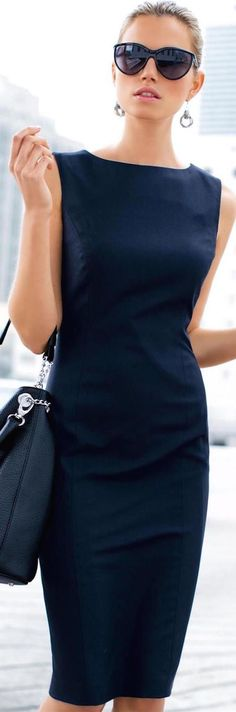 Chic Madeleine Navy Dress. This is the perfect sheath with the perfect at the knee length.