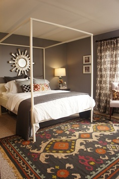 Turquoise : Design Wars for HGTV bedroom... Dark grey walls and sunburst mirror. Print curtains
