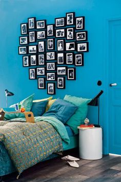 turquoise, teal, citron bedroom with black and white photo wall in heart shape