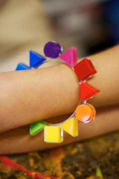 Tatty Devine & Tate Colour Theory Bangle. Wear the entire colour wheel on this bangle in rainbow hues. Squares, triangles and circles chart the progression around your wrist, from pop art red to intense purple, via pea green and sunny yellow. Pep up colourblock outfits and nail the geometric trend at the same time. This bangle will help you find your place on the style spectrum. https://www.tattydevine.com/shop/collaborations/tate/tatty-devine-tate-colour-theory-bangle.html#