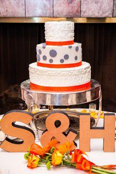 Whimsical orange and gray wedding cake