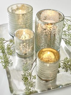 Handcut glass candle holder contrasts smooth glass and rough edges to add drama and sparkle when illuminated. Silver exterior gets extra glow from warm gold interior.