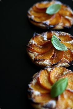 Mini peach tarts - http://www.nordljus.co.uk. Consists of thin pastry and poached peaches, with frangipane filling (with custard and almond cream) thinly spread on top of the pastry. The final flourish is some shredded basil leaves. Although the recipe calls for yellow flesh peaches, it would work with other fruit too such as pears, nectarines, apricots or plums. :)