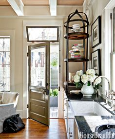 Soft colors are restful: a custom beige on the walls; Benjamin Moore's Cromwell Gray on the door and White Dove on the trim.