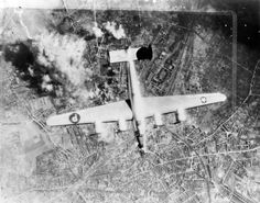 A B-24 Liberator of the 467th Bomb Group during a mission over Osnabruck. Handwritten caption on reverse: 'Osnabruck 23/3/45 467 BG.'