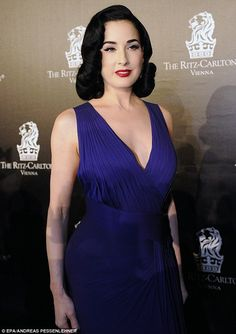 True blue: Dita Von Teese looked stunning sporting her trademark curls and red lipstick