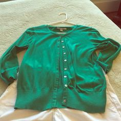 Kelly green cardigan 3/4 sleeves. Light weight. This one has been loved, but has some life left. Old Navy Sweaters Cardigans