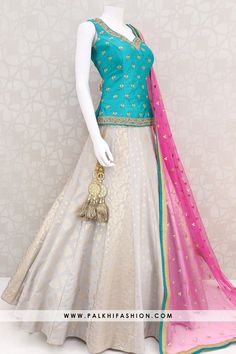 light grey designer lehenga choli from palkhi fashion with silk embossed work.Teal long blouse with deep pink soft net dupatta. Party Wear Indian Dresses, Indian Fashion Dresses, Indian Gowns Dresses, Dress Indian Style, Indian Designer Outfits, Indian Long Dress, Pakistani Clothing, Abaya Style, Kurti Designs Party Wear