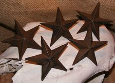 """Cast Iron Star Nail Set of 10 Wall Garden Home Country Decor Rustic Primitive Western Cowboy  •This listing is for TEN Cast Iron Star Nails •Great for a rustic or western-themed home or garden project! •Very sturdy cast iron with rusty brown finish and nice detail •The photographs taken outdoors with natural lighting more realistically depict the actual color of the items. •Measures 3"""" across X 3"""" tall. •Nail on back for easy mounting on wall or fence •Free Shipping!"""