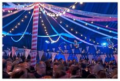 pennants, blue lights and string lights make for a very festive tent