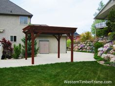 Solid wood 12x14 full size timber framed dovetailed pergola built using old world craftsmanship without the use of unsightly hardware; built to stand against strong winds and heavy mountainous snows. westerntimberframe.com