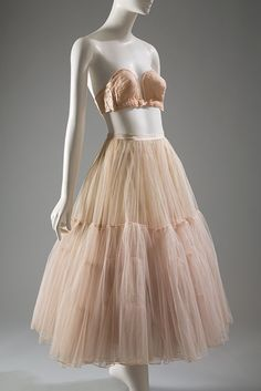 "Christian Dior's 1947 ""New Look"" collection heralded a return to the hourglass silhouette. The bust became a focal point, and its shape was defined by a variety of highly structured bras and corselets. Petticoats were often worn to maintain skirt fullness. This petticoat by Dior was made especially for one of his couture gowns."