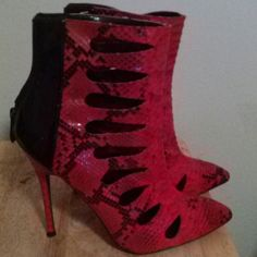 Lowered today Sexy snakeskin cutout boots I only wore I couple of times and has a small scuff right shoe see last pic, not very noticeable.  Red and black with 5 in heels. I received sooo many compliments when I last wore them.   The pic does no justice. I am cleaning out my closet and would love to sale them. PRICE FIRM. Shoes