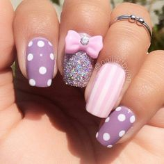 Purple polka dot with pink stripes and pink bow glitter nail art