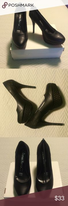 Black Pumps Brand new. Still in box. Purchased in Mexico but decided I didn't like them anymore. Shoes Platforms