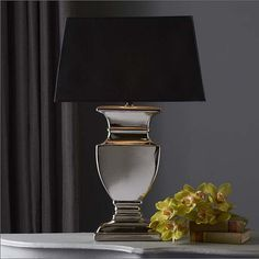 Tozai Home Urn Silver Lamp: Classic in design, this handsome silver urn lamp is made of ceramic with black paper shade.  Sure to be a hit in the study, as well as a chic accessory for the modern living room or boudoir.  Larger is 8 1/2