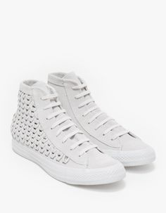 From Converse, a classic hi-top sneaker in white updated with woven suede construction. Features woven suede uppers, lace-up closure, textile lining, Chuck Taylor logo patch at the inside ankle and rubber outsole with custom Diamond tread traction.  • H