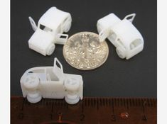 3-D Printed Micro car with open doors and turning wheels by David Sun on Shapeways