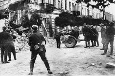 Nazi soldiers searching for Polish snipers during the Warsaw Uprising