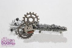 Steam punk buttonhole / corsage for a groom or groomsmen for a wedding.  Cogs, Metal, Wire, Watch Peice