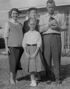 Little Farrah Fawcett with her parents and grandmother ~ 1958.   Look at the tiny puppy her dad is holding!