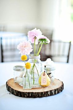 Love the wood board to set the flowers on.  Great idea for cocktail hr tables.  More rustic flowers though