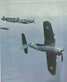 Early production F4U-1 initiates 'side slip' maneuver during a flight over Guadalcanal, 1943 . . .