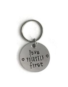 This is a 1.25 inch aluminum circle keychain, made from either 10 (super thick, pictured) or 12 gauge (a bit thinner) aluminum. Choose to have both side pictured, or always keep fighting or love yourself first on both sides. Will not rust or tarnish. $1 from each keychain purchased is donated to suicide prevention.
