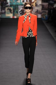 tracy reese. orange peplum jacket with black skinny pants. black and white printed blouse.  I want this look