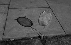 Shadow art on Sidewalks from a cooking strainer.