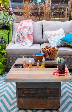 A cedar table with a faux-reclaimed finish will be the center of attention on your patio. Raise a top plank for easy access to a 5-gallon drink bucket inside.