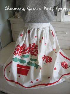 Half apron, for sale only...no instructions.  At a garage sale I recently purchased Greek Linen with beautiful hand painting floral designs.  Thinking I could use that to make something similar to this. I'm Pinspired!