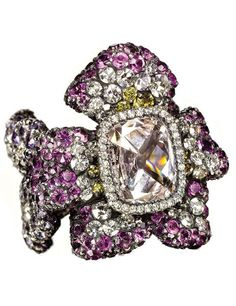 A violet-shaped amethyst-and-diamond ring. JAR