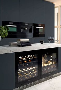 Miele Kitchen. I spy a decanter (which always comes in handy). Clean lines. Marble counter top. Built in wine cabinet. Lovely.