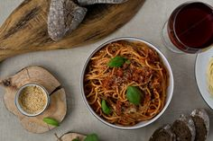 Spaghetti Bolognese - top view.  by kawizen  on @creativemarket #spaghettibolognese, #bolognese, #spaghetti,#pasta, #italiancuisine,#italiandish, #italiandiet,#tomato,#tomatoes, #fresh,#herb,#herbs,#basil, #leaves,#basilleaves,#parmesan, #vegan,#vegetarian, #filling, #tasty,#delicious,#gourmet, #glass, #water,#wine,#redwine, #woodcoaster, #woodcoasters, #woodboard,#woodcuttingboard, #whiteplates,#baguette, #bread, #dine,#dining,#closeup,, #tabletopview,