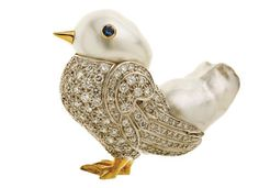 """Eclectic Jewelry and Fashion: Fine Jewelry: """"Animal Luxe"""" Seaman Schepps' 18-karat gold, South Sea pearl, diamond and sapphire bird brooch."""