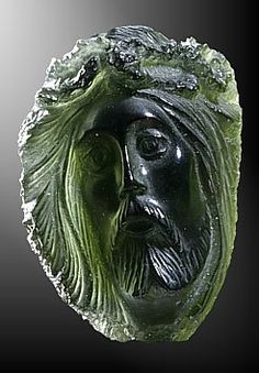 Moldavite cameo carved out of the famous green Czech tektite which originates from a meteor impact. Traditional Czech craftwork by TOPGEO.