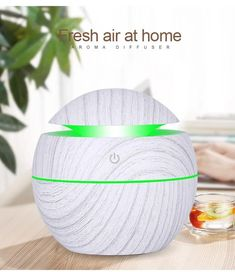 White Bomb Essential Oil Diffuser Specification: Color: WhiteMaterial: ABS + Electronic componentsStyle: Deep wooden-grain/Shallow wooden-grainDiameter: 10cmHeight: 9.5cmCable Length: 95cmRated Power: <3 WattPacking: Color BoxOperating voltage: DC5VCapacity: 130mLMeasuring Mode: Length / Area / Volume / PythagoreanP Aroma Essential Oil, Essential Oil Diffuser, Humidifier, That Way, Rugs On Carpet, Aromatherapy, How Are You Feeling, Shallow, Beats