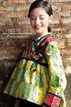 Batik Amarillis webstore http://www.batikamarillis-shop.com/ Batik Amarillis's Shikhara jacket This is Traditional Rabari ( Indian community in Gujarat ) male outfit's inspired ,consists of a fitted bodice with loosely gathered pleats down below with our patchwork's trademark, triple ribbon buttons with front & back yoke make this tribal Look  so unique & special!
