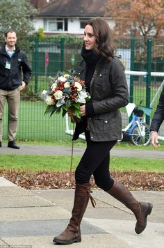 Country Kate! The pregnant Duchess of Cambridge dressed down in a Barbour jacket and her t...