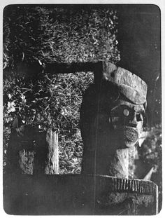 Photograph (black and white) from an album; View of section of drum, with wood carved head. Ikot Idem, Nigeria, 23 June 1905. Gelatin silver print