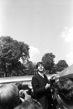 Paul McCartney    The Beatles on a sightseeing trip along the canals of Amsterdam, 6 June 1964. Photo by Inez van 't Hoff.