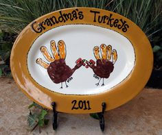 Handprint turkeys painted on serving platter. Fingerprints create feathers. Title is grandma's Turkeys.  Love love love this! So cute! - I hope someone makes me one!!