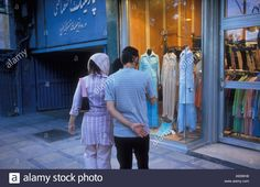Download this stock image: Young couple shopping in northern Tehran, Iran  ©2005 Mark Shenley - A93WH8 from Alamy's library of millions of high resolution stock photos, illustrations and vectors.