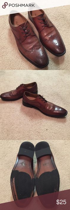 Men's Aldo Dress Shoes Men's Aldo wingtip derby shoes.  Cognac brown genuine leather with a burnished toe.  Genuine leather insoles with rubber outsoles.  Slight creases in leather on the vamp of the shoes. Aldo Shoes Oxfords & Derbys