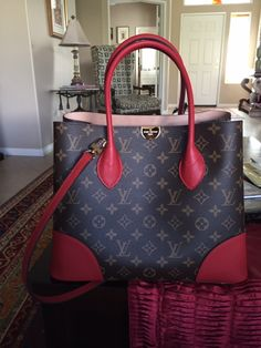 My favorite Louis Vuitton tote...Flandrin..pop of red