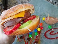 Nutella Burger – warm donut, Nutella mousse, passion fruit gelatin, fresh strawberries and kiwi. - Imgur