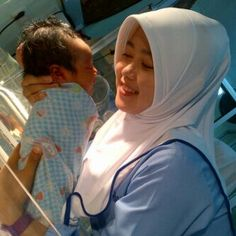 Baby and the midwife, so sweet like mom and son. :)